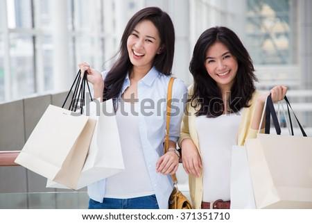 Happy young Asian women shopping. - stock photo