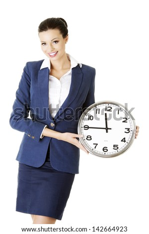 Happy young attractive business woman holding office clock, isolated on white background