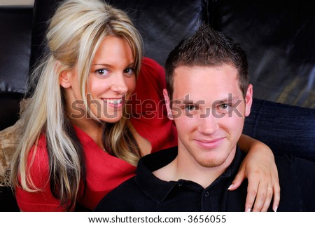 Happy Young Attractive Couple Relaxing Together At Home