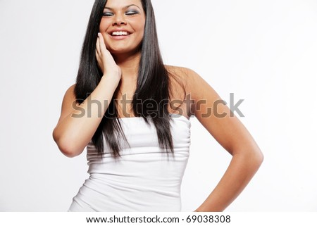 Happy young attractive woman with long black hair. - stock photo