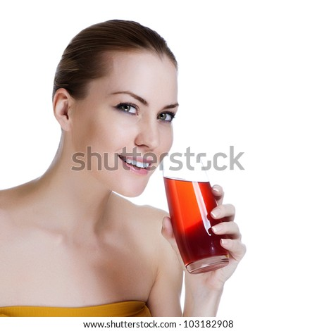 Happy young beautiful female holding glass of fresh juice - stock photo