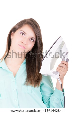 Happy young beautiful woman ironing clothes. Housework - stock photo