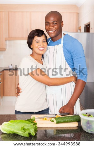 happy young black couple in kitchen