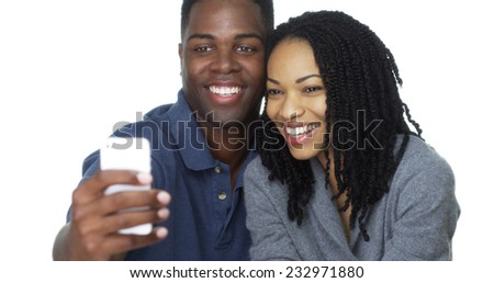 Happy young Black couple taking selfie together and laughing - stock photo