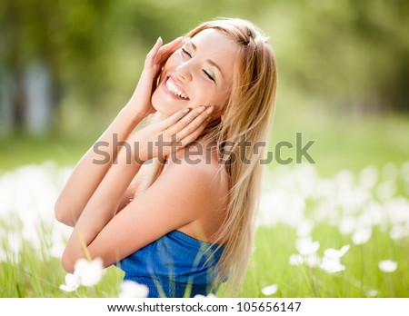 happy young blond woman outdoor on a summer day