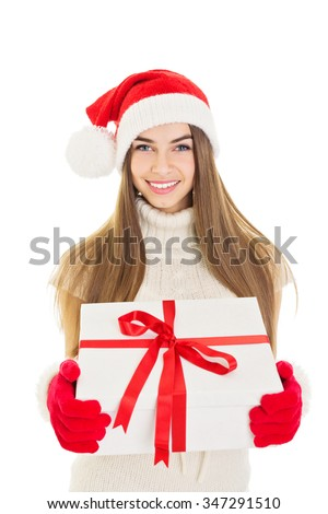 Happy young blonde Santa woman holding a big white gift box with red ribbon. Smiling teenage girl with Christmas present. Vertical, isolated on white background.  - stock photo