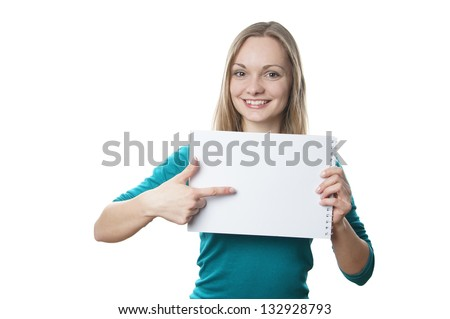 happy young blonde woman holding blank sign and pointing to copy space
