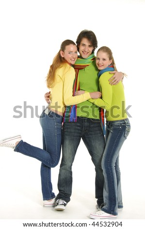 Happy young boy and two girls on white