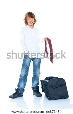 Happy young boy going to travel - stock photo