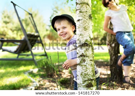 Happy young boy in garden - stock photo