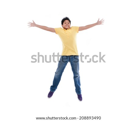 Happy Young boy jumping isolated over white background - stock photo