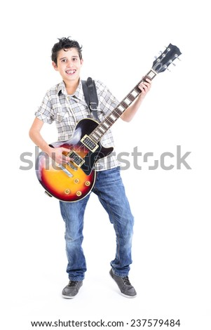 Happy young boy playing guitar