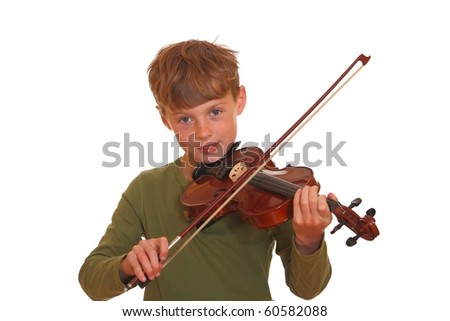 Happy young boy plays his violin