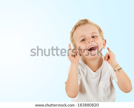 Happy young boy, studio shot, isolated on white - stock photo