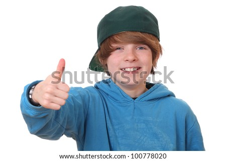 Happy young boy with thumbs up on white background - stock photo