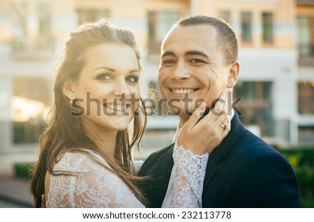 Happy young bride and groom on their wedding day - stock photo