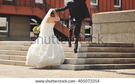 Happy young bride and groom together, wedding couple walking in Copenhagen  - stock photo