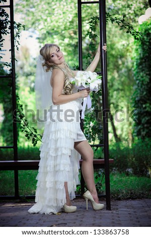 Happy young bride and outside on wedding day - Copyspace. Wedding couple - new family! wedding dress. Bridal wedding bouquet of flowers - stock photo