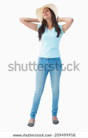 Happy young brunette wearing sunhat on white background