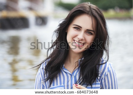 Brunette teen girl in striped shirt