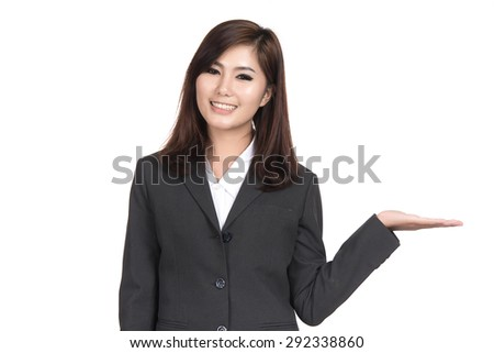 Happy young business Asian woman presenting and showing copy space,Closeup portrait of beautiful Asian woman,Thai girl,Positive human emotion facial expression,isolated on white background