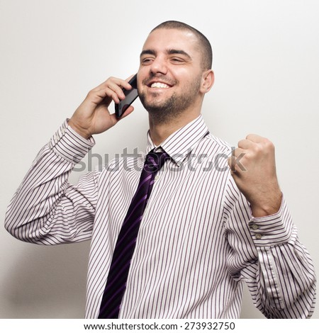 happy young business man celebrating - colorized photo - stock photo