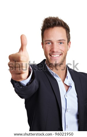 Happy young business man holding his thumbs up - stock photo