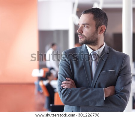 happy young business man portrait  at modern meeting office indoors - stock photo