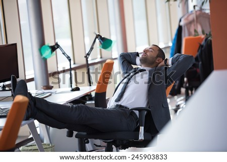 happy young business man portrait in bright modern office indoor