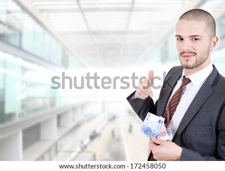 happy young business man with money at the office - stock photo