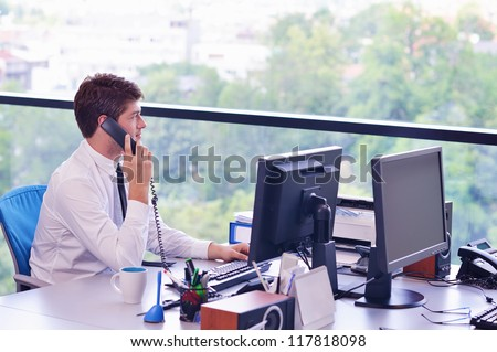 happy young business  man work in modern office on computer - stock photo