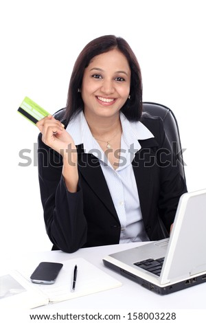 Happy young business woman doing on line shopping against white