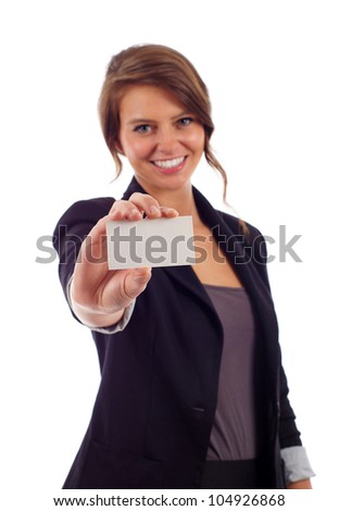 Happy young business woman holding a blank  business card at arm's length isolated over white background - stock photo