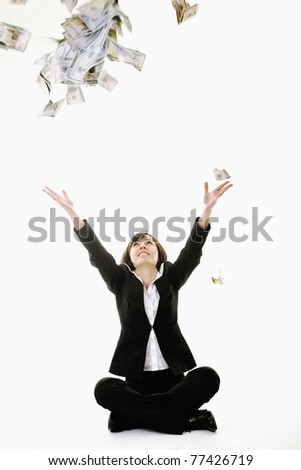 happy young business woman isolated on white playing with dollars money and representing success in finance - stock photo