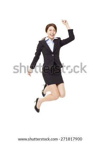 happy young business woman jumping - stock photo