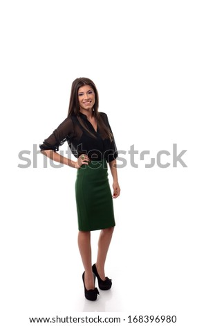 Happy young business woman posing with one hand on waist over white background - stock photo