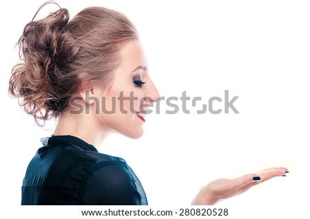 Happy young business woman presenting something on her palm, isolated on white - stock photo
