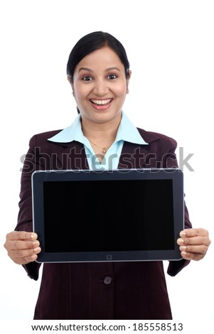Happy young business woman showing tablet computer screen against white