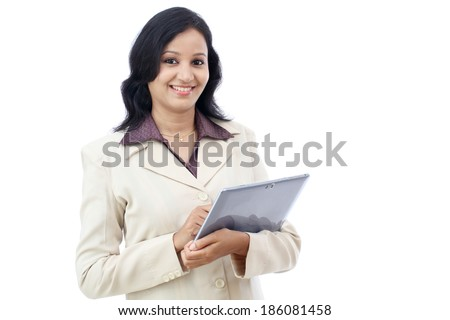 Happy young business woman with tablet against white