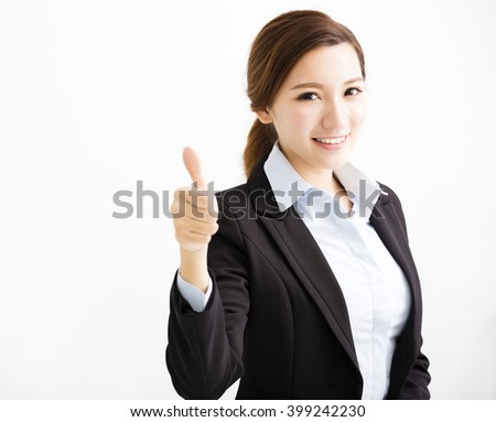 happy young business woman with thumb up - stock photo