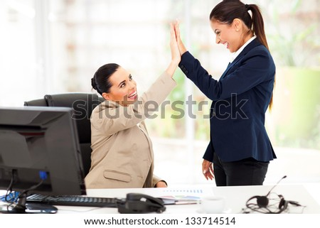 happy young business women doing high five in office - stock photo
