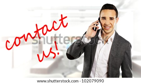 happy young businessman calling with smartphone speaking contact us