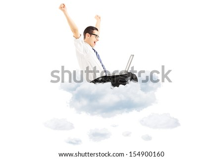 Happy young businessman flying on clouds with laptop and gesturing happiness isolated on white background - stock photo