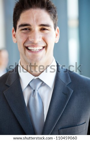 happy young businessman laughing - stock photo
