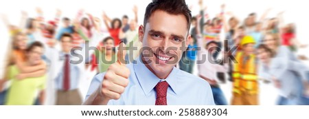 Happy young businessman near people group background. - stock photo
