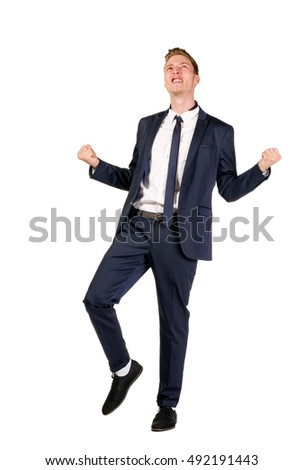 Happy young businessman raised fists isolated on white