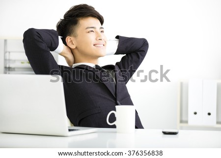 happy young  businessman relaxing in office - stock photo