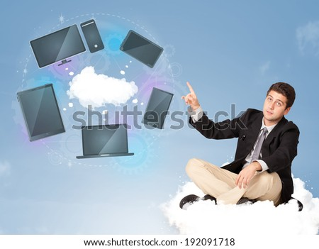 Happy young businessman sitting on cloud enjoying cloud network service - stock photo