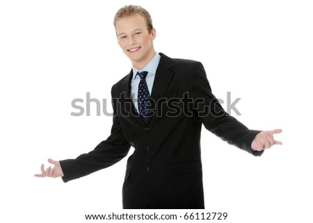 Happy young businessman standing, isoalted on white background - stock photo