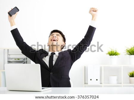 happy young  businessman working in office - stock photo
